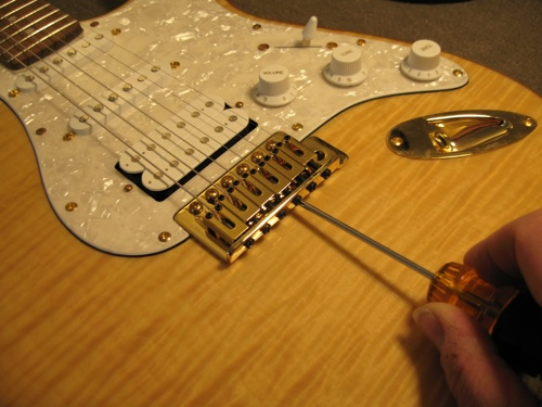 adjusting the nut on a guitar