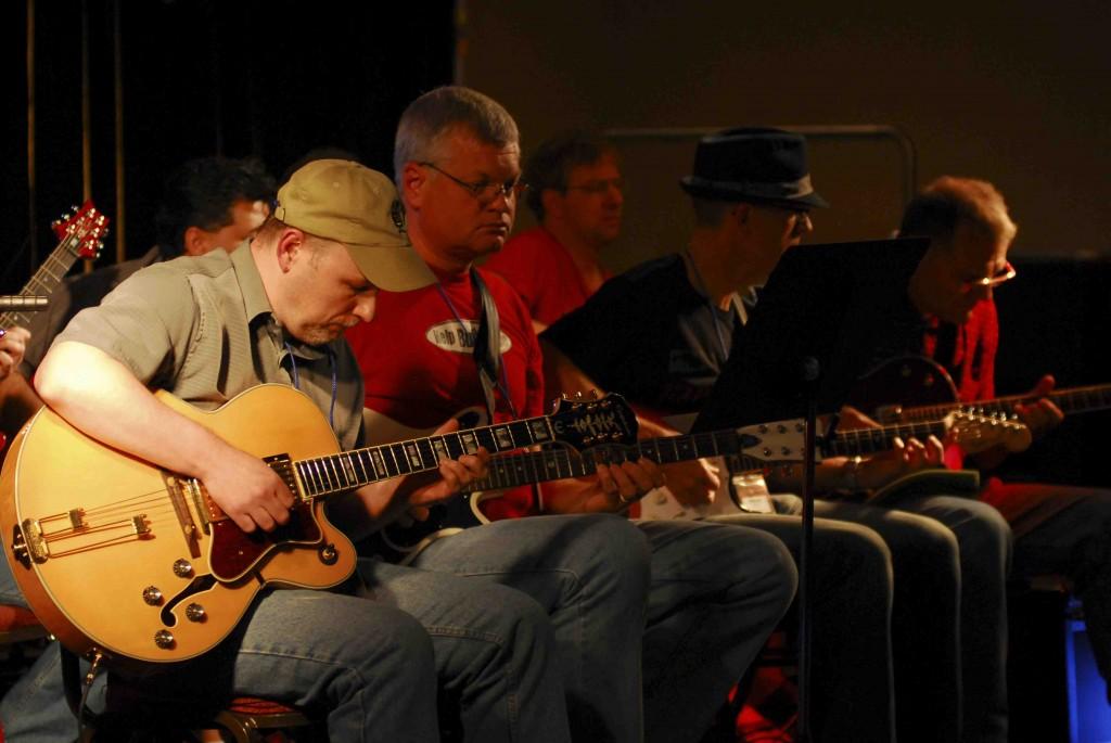 guys playing guitar