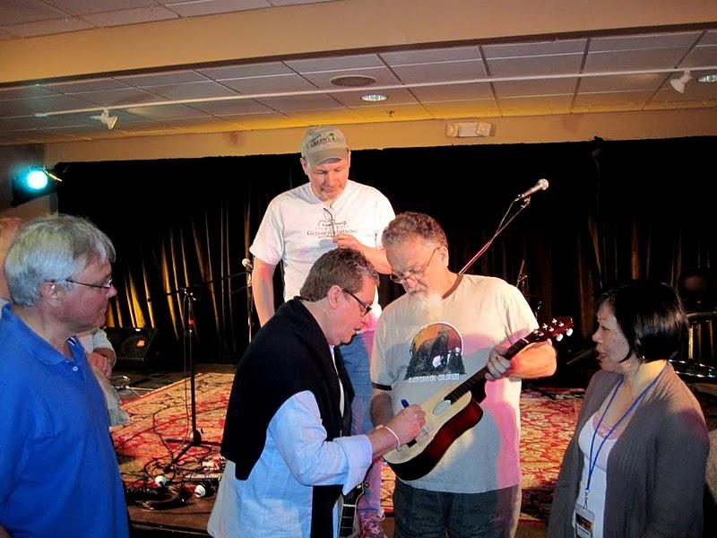 Martin Taylor Signing a Guitar