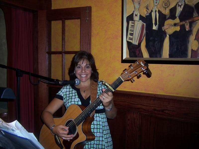 Maria with acoustic guitar
