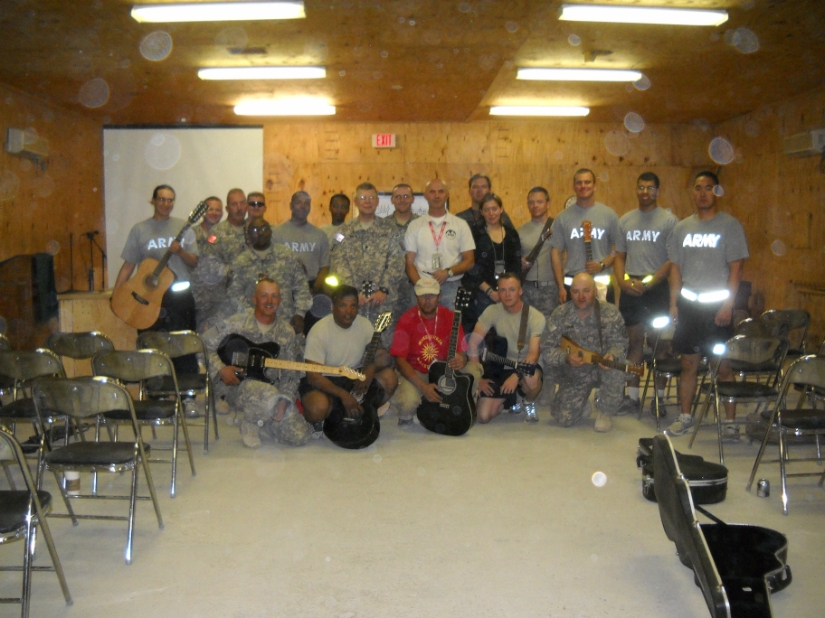 troops at a guitar lesson