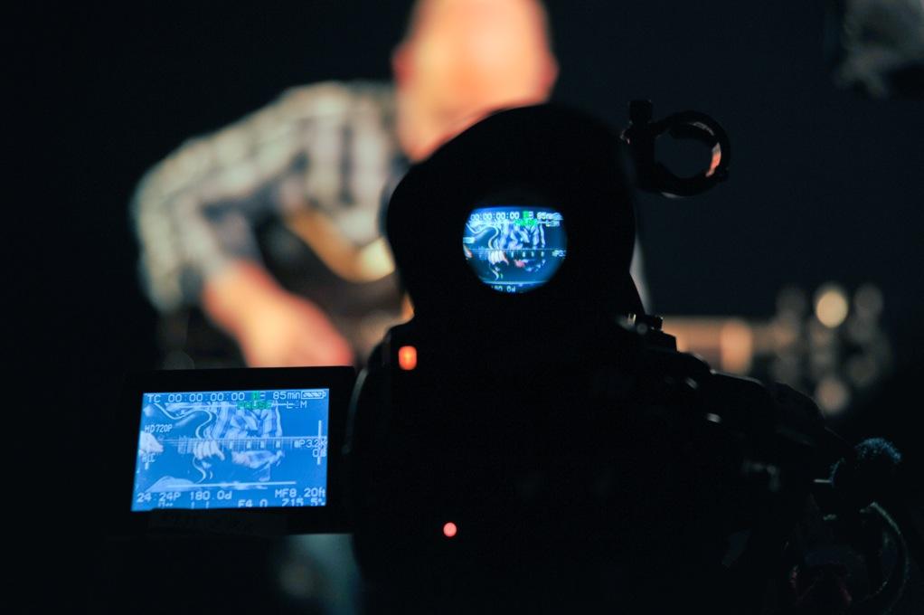 camera recording a guitarist