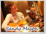 Sandy Mason Playing Guitar