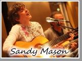 Sandy Mason Playing Guitar